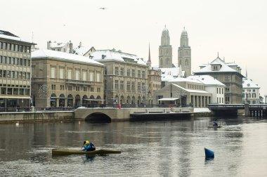 Canoeist on the limmat river in Zurich