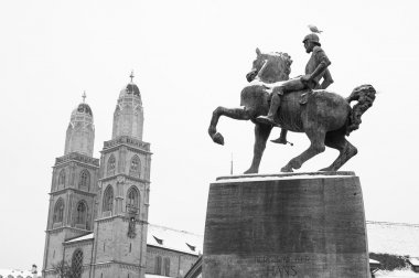 Snow covered statue of rider