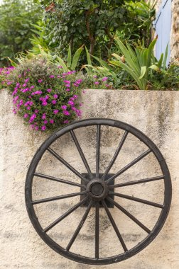 Wooden wheel on the wall