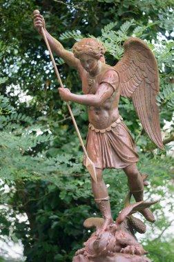 Rusty Statue of St. Michael