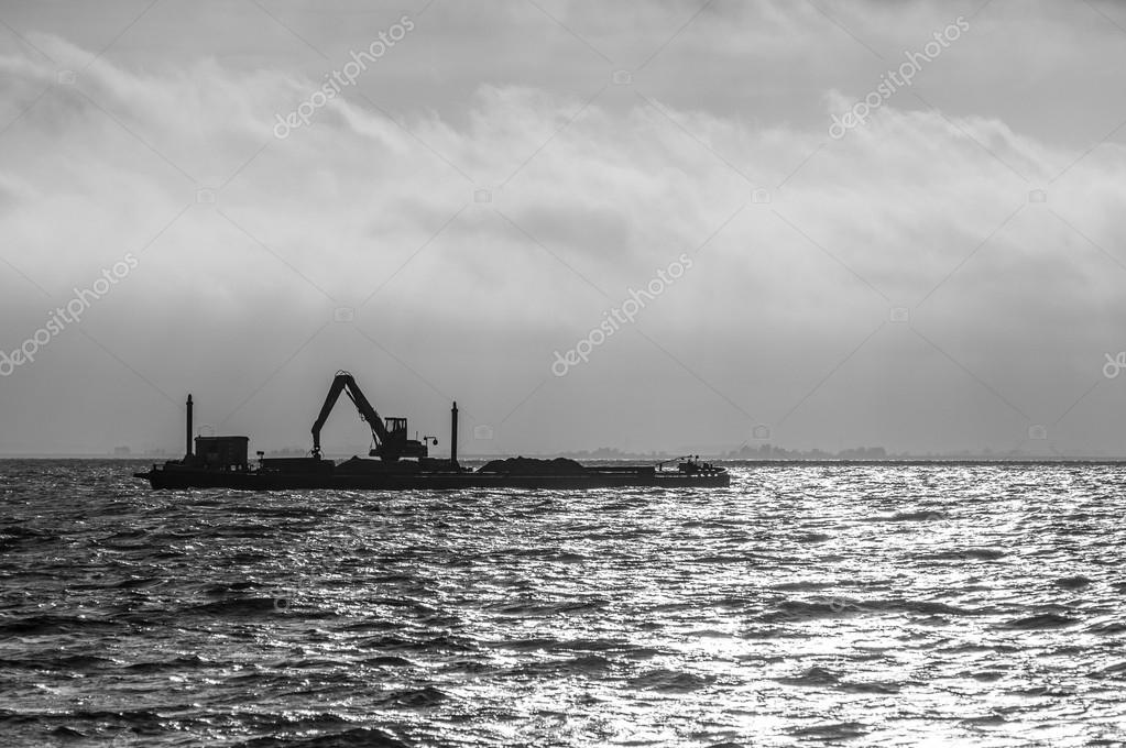 Silhouette of Ship carrying crane