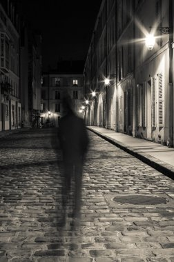 Cobblestone street at night in Paris
