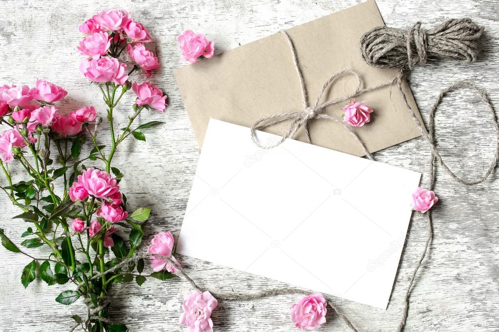 blank white greeting card with pink roses bouquet and