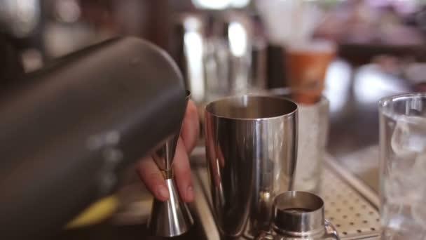 Bartender make cocktail in a bar