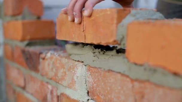 Work lays bricks on a construction site