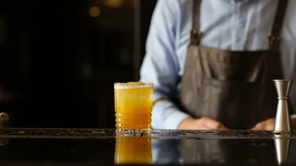 Barman cocktail decorated with a slice of orange