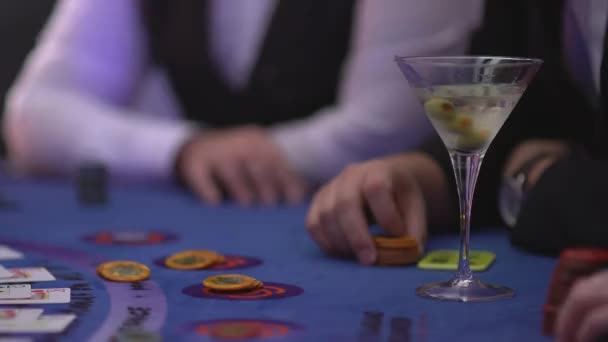 Gambling Black Jack in a casino - Gambler asking for cards - James Bond style