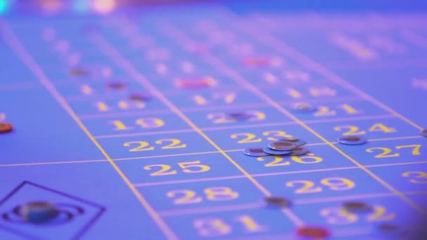 Roulette table in a casino - removing lost bets from table