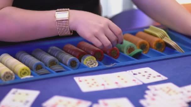 Gambling Black Jack in a casino - dealer paying wins