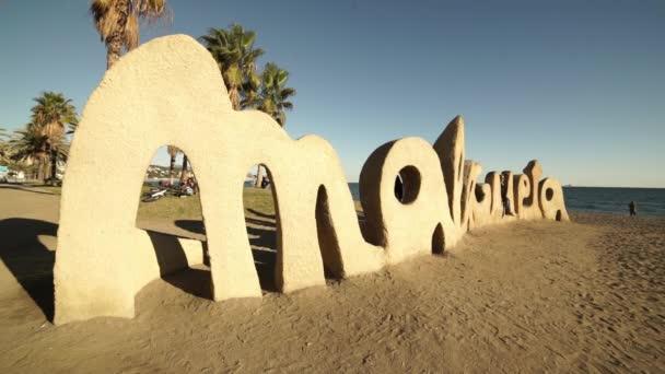 Malagueta writing at Malaga beach