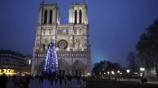 The famous Notre Dame Cathedral in Paris in the evening