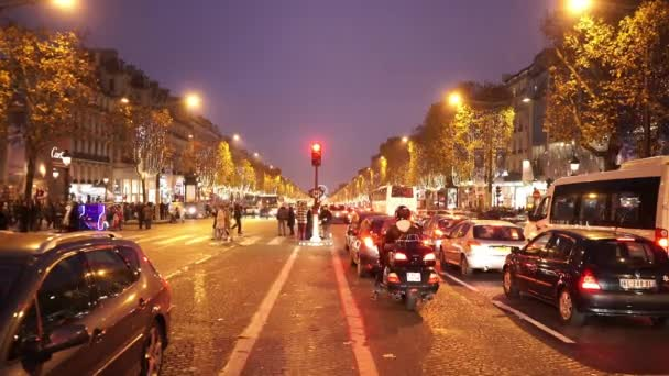 Famous avenue Champs Elysees in Paris in the evening
