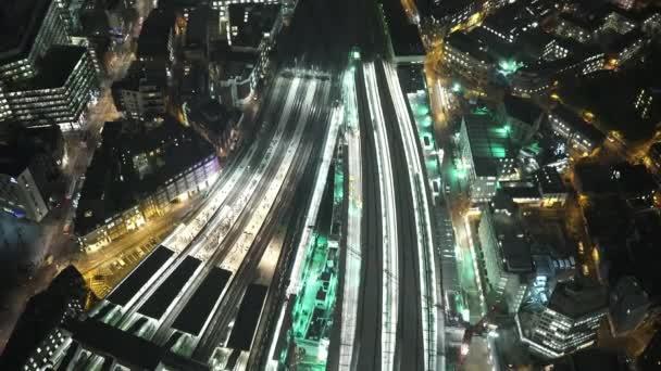 Illuminated railway tracks at London Bridge station by night amazing shot  - LONDON, ENGLAND
