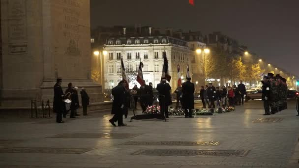 Military parade at Arc de Triomphe in Paris by night - PARIS, FRANCE