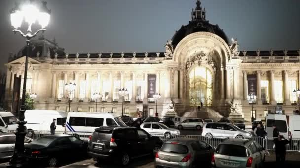 Small palace called Petit Palais exhibition hall in Paris by night - PARIS, FRANCE