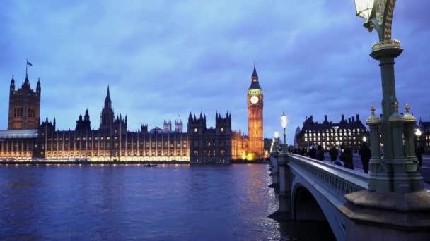 People walking over Westminster Bridge in beautiful London  - LONDON, ENGLAND