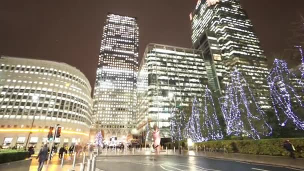 Panning shot of Canary Wharf at Christmas time by night  - LONDON, ENGLAND