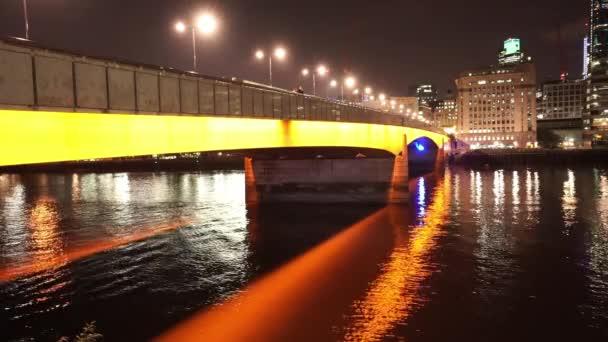 Orange illuminated London Bridge by night  - LONDON, ENGLAND