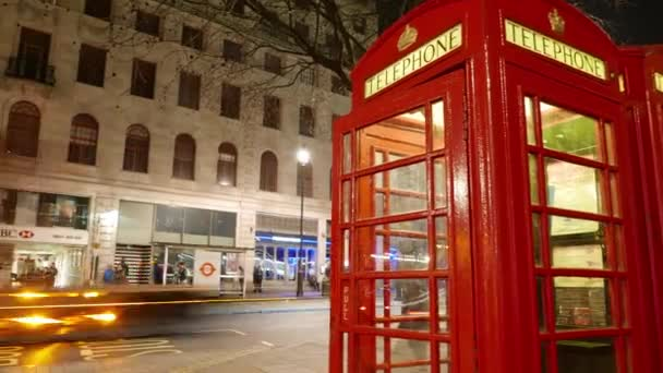 Time lapse shot of British telephone booth and street traffic Hyper lapse