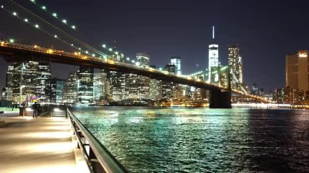 Impressive New York skyline with Brooklyn Bridge by night New York, USA