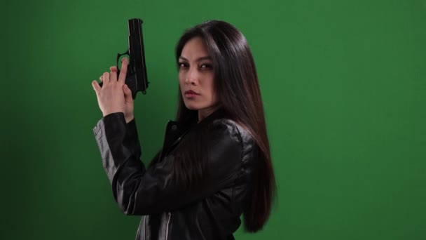 Female agent with a gun in her hands
