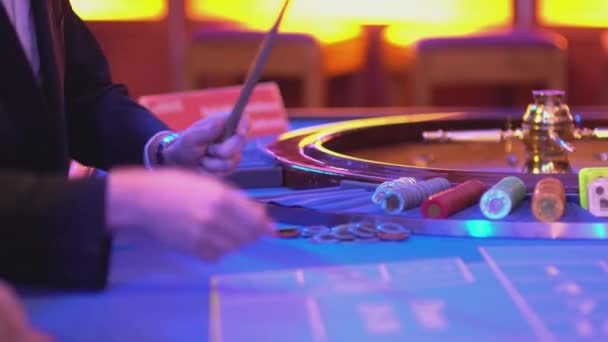 Roulette table in a casino - groupier at work