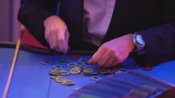 Roulette table in a casino - groupier collects and sorts gaming chips