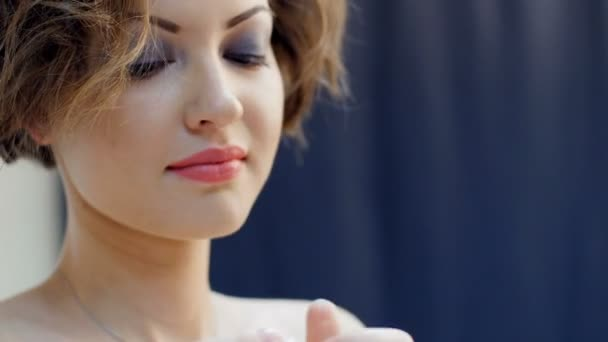 beautiful girl wears earrings - photosession