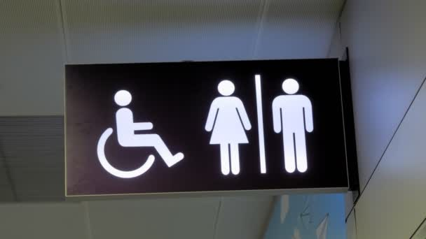 sign. pointer. toilet or WC. Signboard handicap toilet sign, toilet for people with disabilities. Female and male symbols on plates for public toilets, water closets. Pointer wc at the airport
