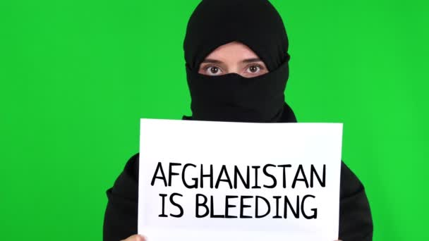 Afghanistan. Protest for Afghanistan. tagline. View of sign Afghanistan is bleeding. Taliban Afghanistan war 2021.