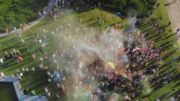 powder paints. aero. aerial top view. Many people having fun, enjoying of throwing with dry color powder during festival of colors, in the park . summer.
