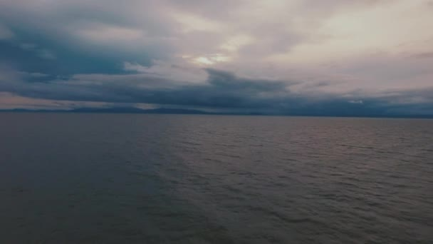 Flying over calm ocean .