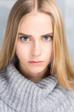 Portrait of a beautiful girl with blue eyes