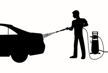 Silhouette of Man washing a car