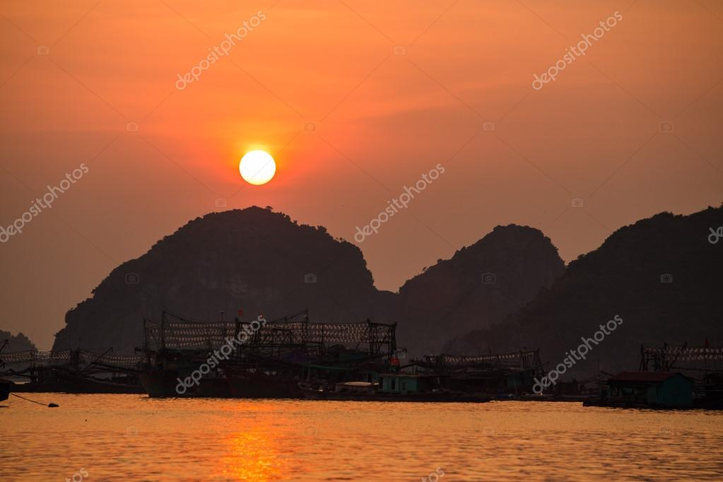 Asian fishing boats at sunset