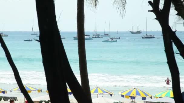 Kings Cup Regatta. Kata beach, Phuket, Thailand. Yachts, and beach area with sun shades on the Sea.