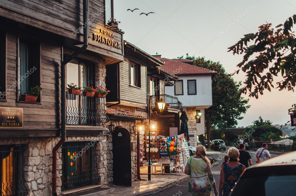 People walk through the old town of Nessebar.