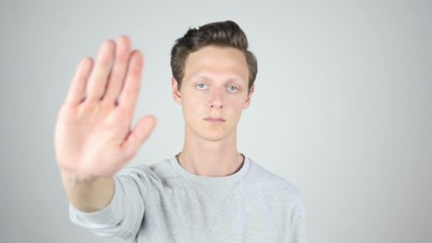 Stopku, není dovoleno, izolované gesto mladý muž