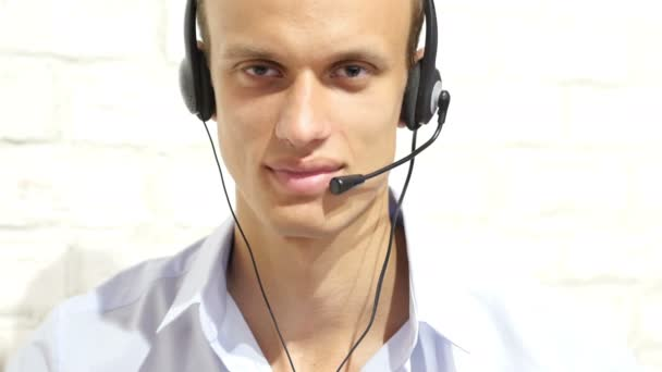 Customer service representative wearing a headset at the office , call center