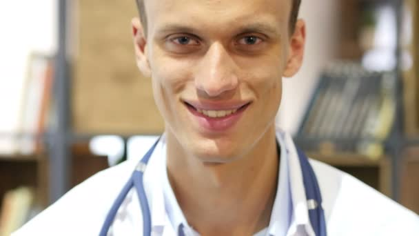 Portrait of friendly male doctor smiling in Clinic