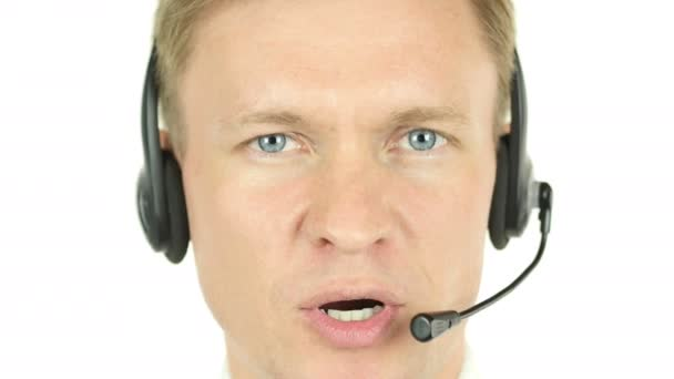Agent Face Talking,  working in a call centre with his headset