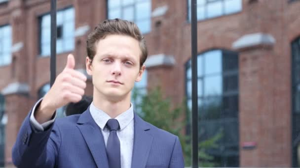 Thumbs Up for Success by Businessman