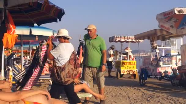 Clothes Merchants hope to sell their goods on the beach