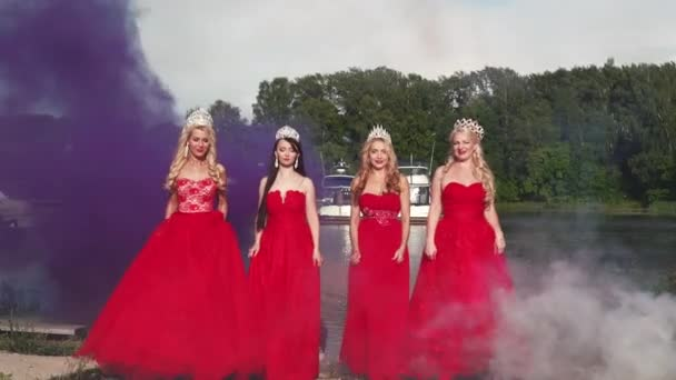 4 Queens of beauty in red dresses with the crowns