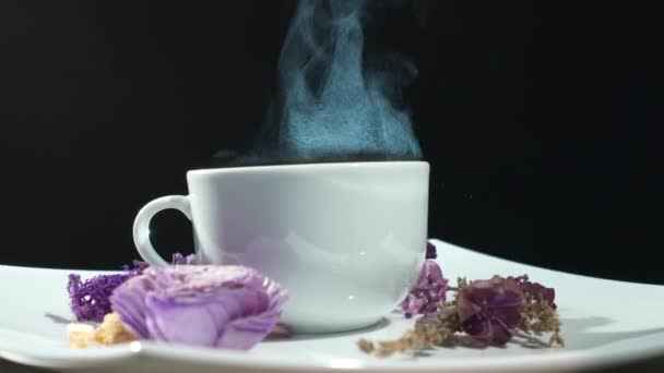 Steaming Cup of tea with flowers rotation