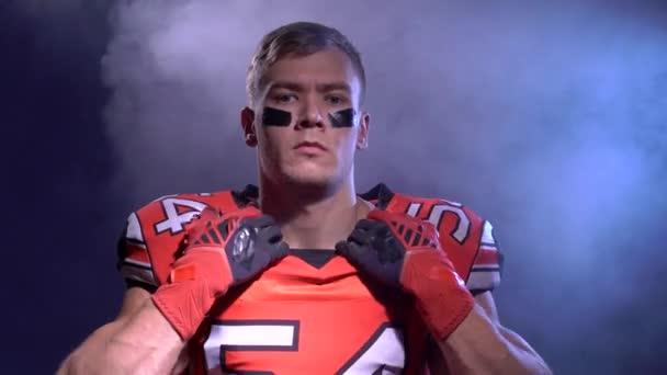 American football player warming up in smoke