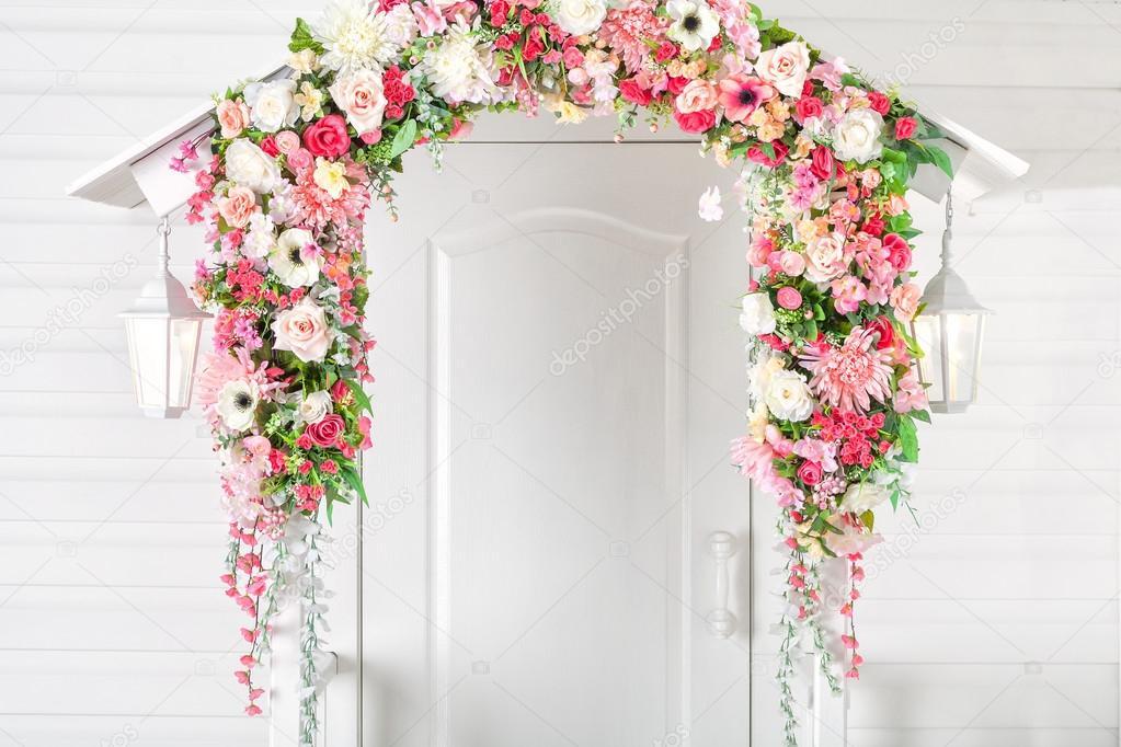 Input white door, porch and street lights . Flower arch. Spring.