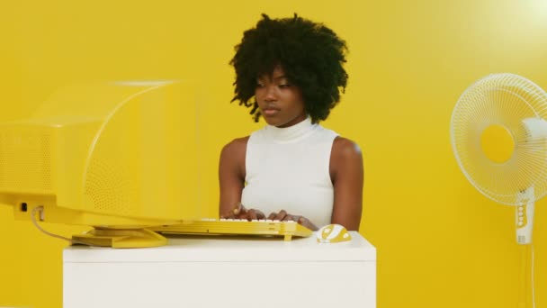 African Woman Is Using Yellow Retro PC