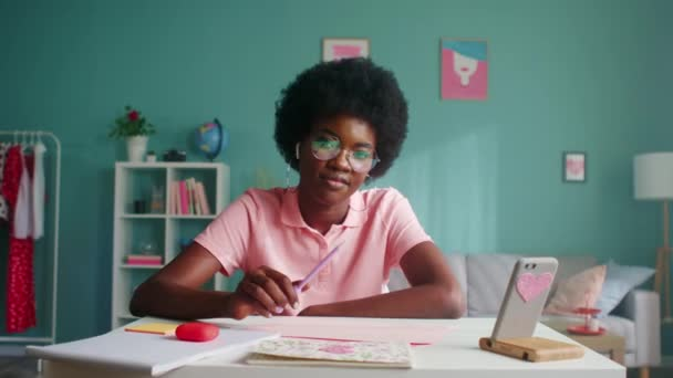 Portrait of Woman Student in Pink T-Shirt