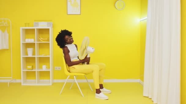 Portrait of Black Woman Relaxing In Yellow Office